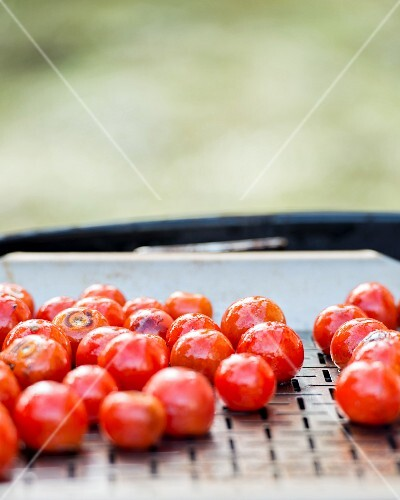 Cherry tomatoes on a barbecue