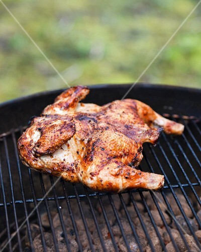 Spicy marinated chicken on a barbecue