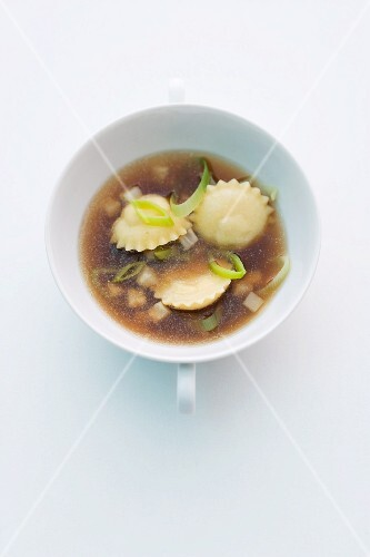 Duck broth with truffle and onion ravioli