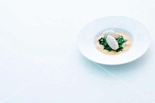 Hake and crayfish dumplings on charred with crab foam