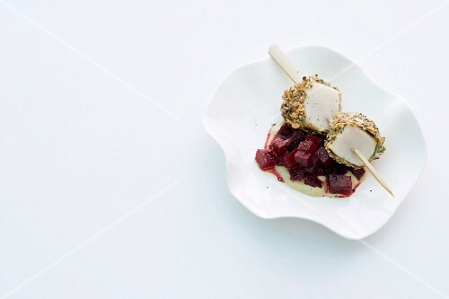 Scallop skewers with a pumpkin seed crust on beetroot with horseradish foam