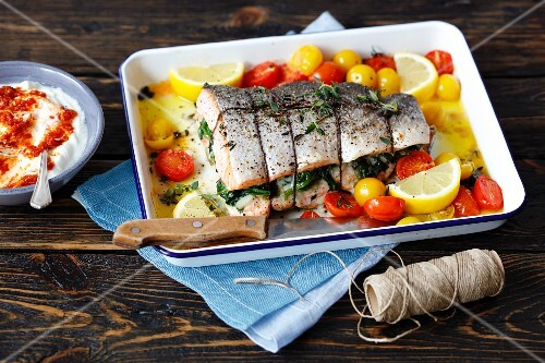 Salmon with spinach and prawn filling and roasted cherry tomatoes