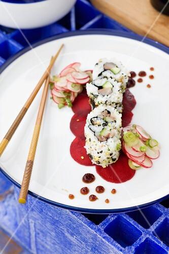 Ura maki on beetroot with a radish salad
