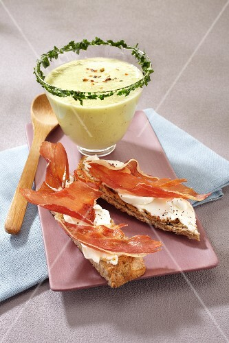 Grilled bread topped with raw ham served with cold cream of cucumber soup