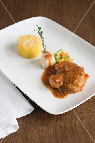 Cotoletta alla milanese with vegetables and polenta