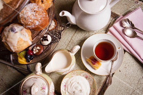 High tea: afternoon tea with cakes and pralines (seen from above)