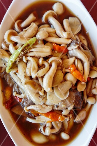 Stir-fried mixed mushrooms with chillis