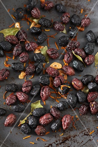Dried olives with garlic and bay leaves