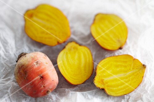 Yellow turnips on a piece of white parchment paper