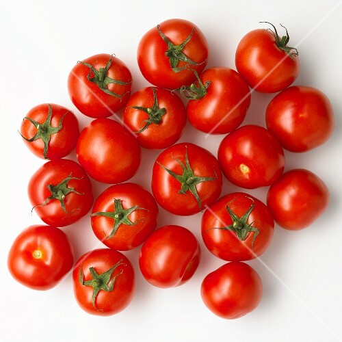 Tomatoes on a white surface (seen from above)