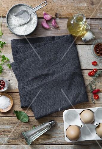 Pasta ingredients on a dark napkin (seen from above)