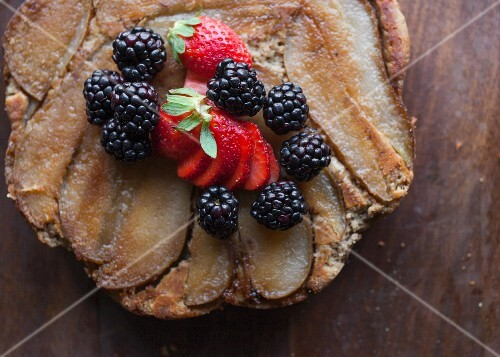 Organic, gluten-free pear tart with fresh berries