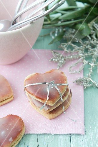 Heart-shaped biscuits covered with jam