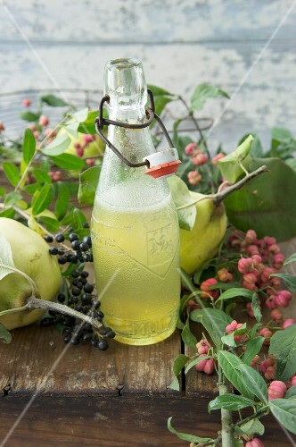 Quince syrup in a bottle