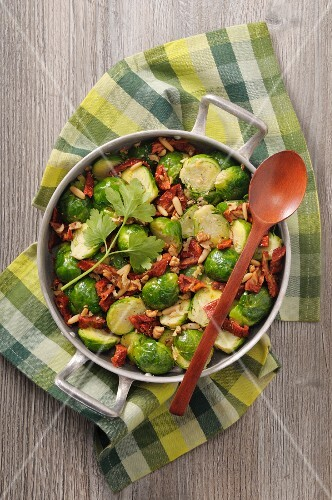 Fried brussels sprouts with dried tomatoes and pine nuts