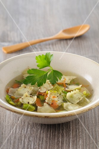 Clear vegetable soup with ravioli
