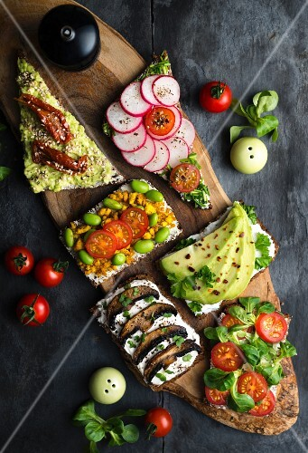Wholemeal open sandwiches topped with soya quark and various vegetables