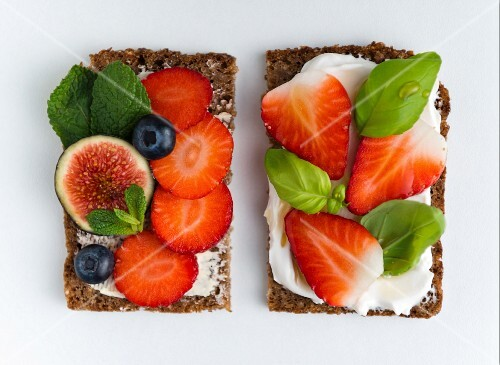 Wholemeal open sandwiches with soya quark and various fruits