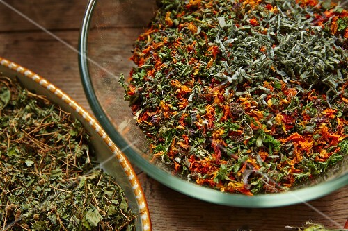 Bowls of dried salad herbs