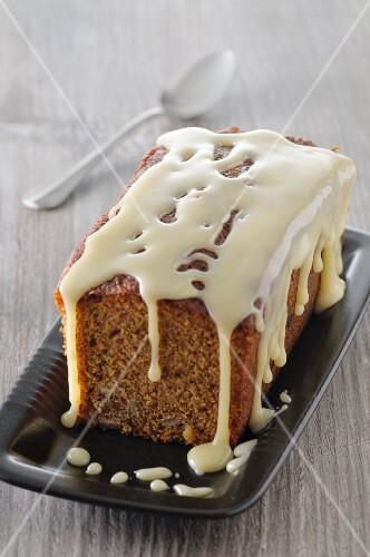 Loaf cake with white chocolate glaze, sliced
