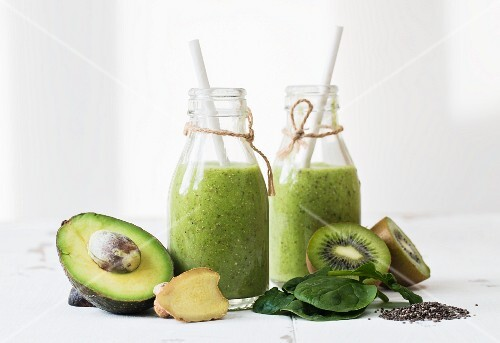 Green smoothies with avocado, kiwi, spinach, ginger and chia seeds