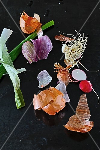 An arrangement of onions and radishes