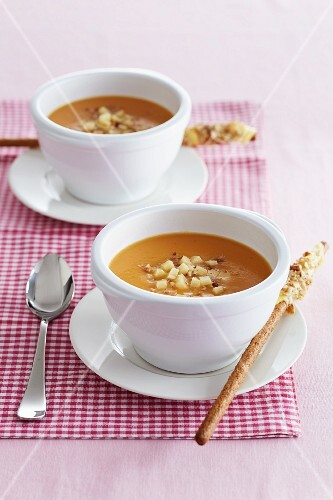 Pumpkin soup with potatoes and nuts