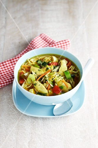 Oriental noodle soup with chicken and vegetables