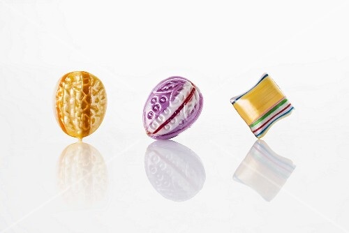 Colourful sweets on a white reflective surface