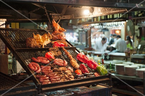 Grilled meats on a cooking grid at a market in Argentina