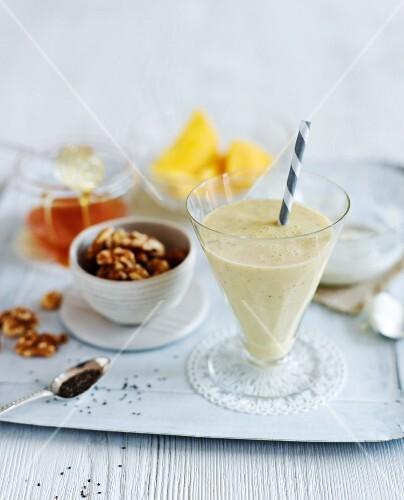 A nutrient rich milkshake, nuts, honey and mango