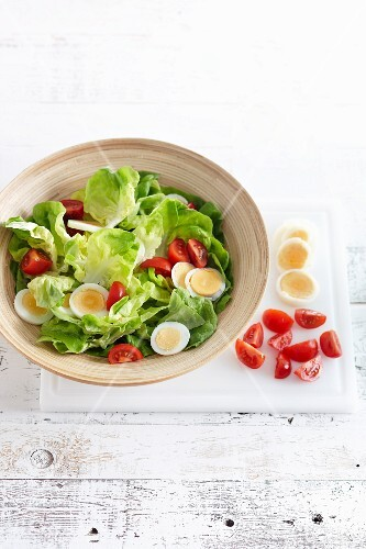Green salad with cocktail tomatoes and hard-boiled eggs