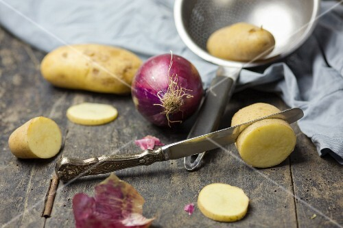 Red onions and carrots on a rustic table