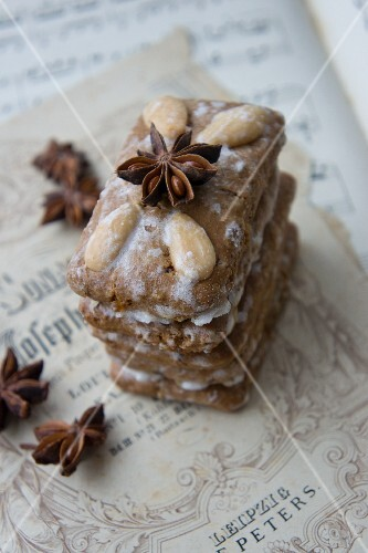 Elisenlebkuchen (Nuremburg gingerbread cake) with star anise on a piece of sheet music