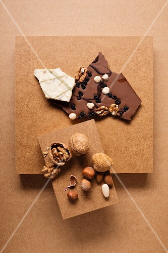 Chocolates and a nut mixture consisting of almonds, walnuts and hazelnuts on a cardboard box