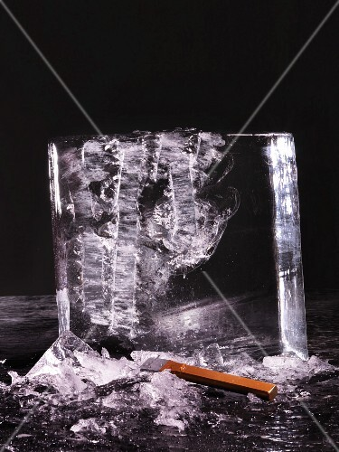 A chopped block of ice against a black background