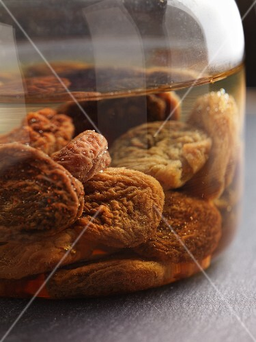 Dried fruit being softened in warm water for later use