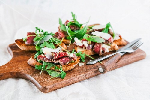 Crostini with carpaccio, rocket, capers and pecornio romano cheese
