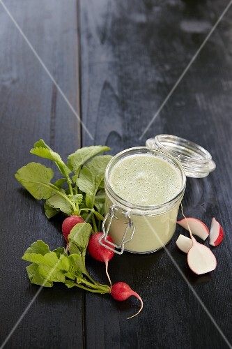 A radish and cucumber smoothie in a jar