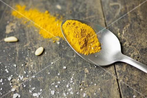 Turmeric powder on a spoon
