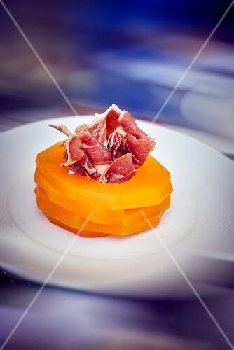 Melon slices with ham