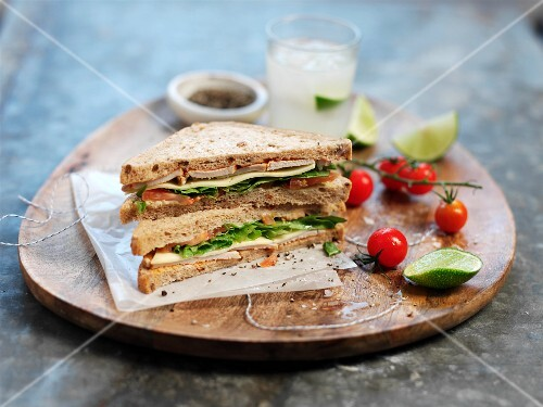 Chicken sandwich with cheese, lettuce and tomatoes