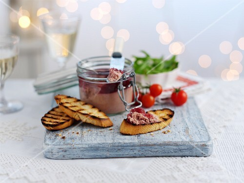 Pâté in a flip-top jar with grilled bread for Christmas