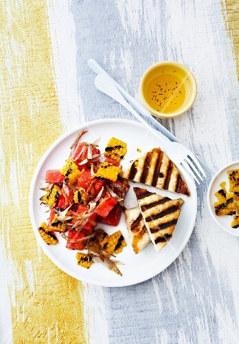 Grilled bread with a watermelon and sweetcorn salad