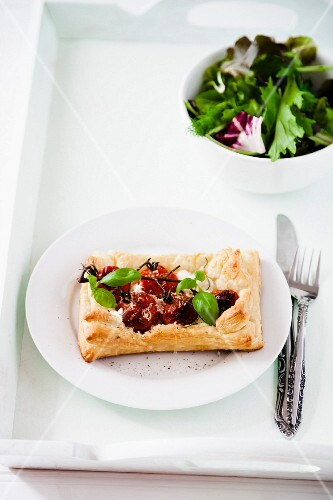 A tomato puff pastry and a green salad