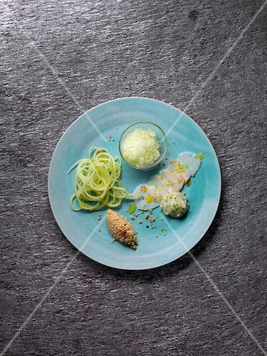 Variations of scallops with cucumber spaghetti, mushroom quinoa and gin and tonic granita