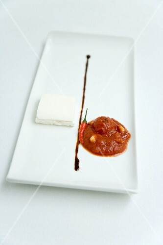 Tomato and chilli chutney with goat's cream cheese