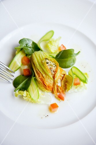 Courgette flowers filled with prawn tartare and vegetable couscous