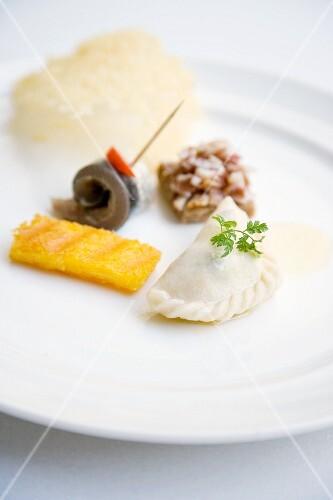 Kärntner Nudel (Austrian ravioli filled with quark and potatoes) with polenta and sardine rolls