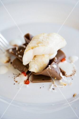Fried sole fillet with cocoa pasta and coconut sauce